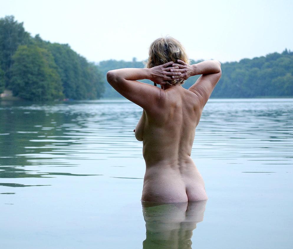 Busty Stunner Sunning Herself Outdoors Nude