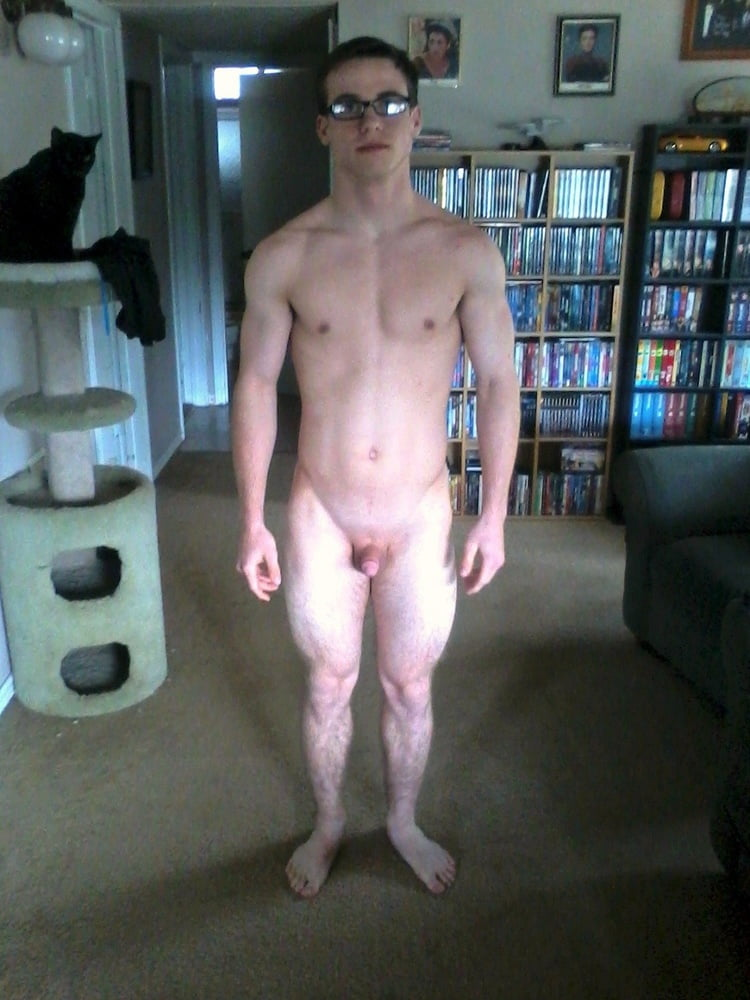 Nerdy guy is stroking his hard dick off