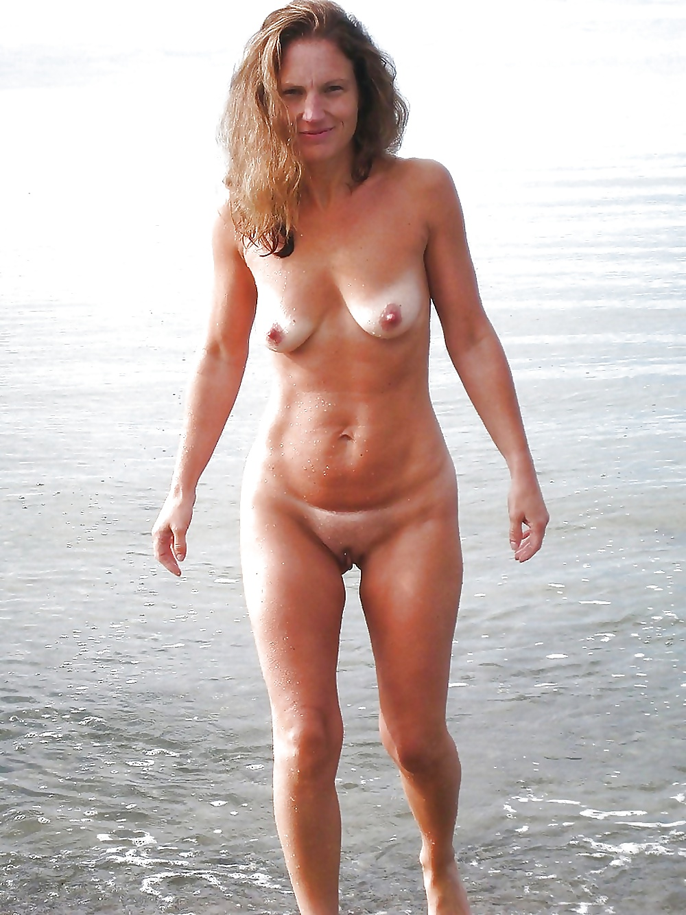 Warm Nude Mature At The Beach Images