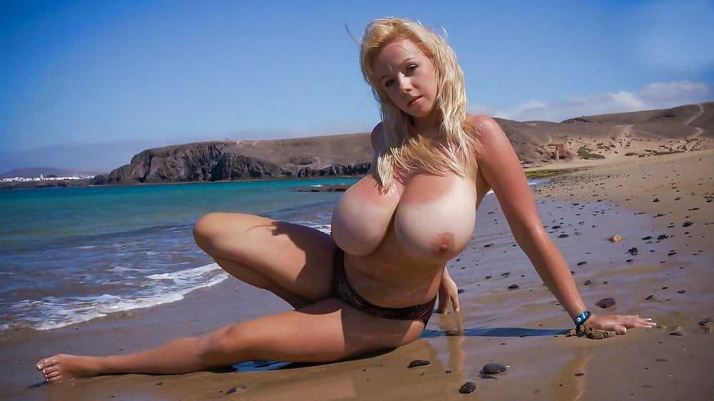 Mad From Huge Titted Woman On Beach Has Wet Pics 1