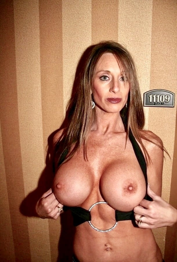 A hot wife with huge fake tits takes a big magic wand while her hubby sleeps