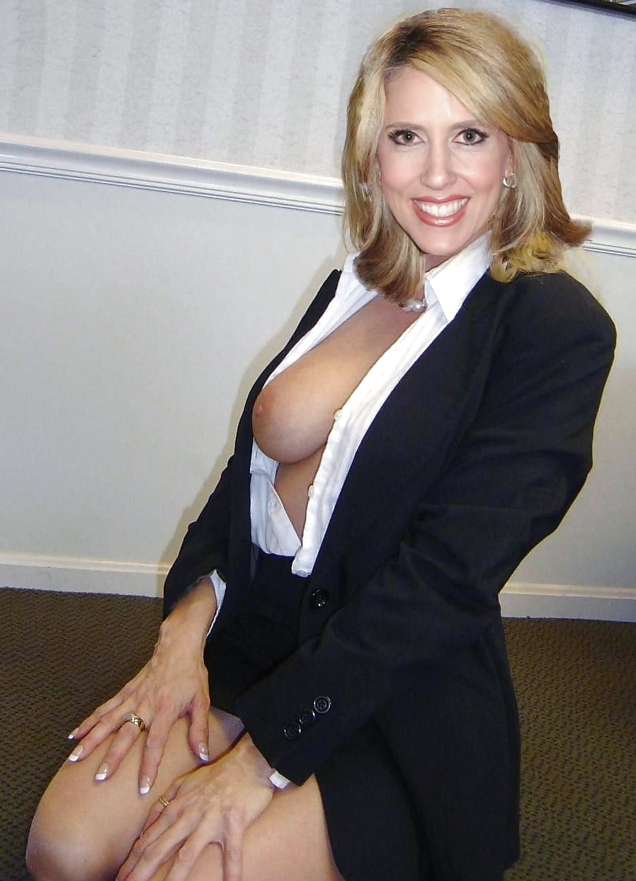Red young woman in sexy business suit