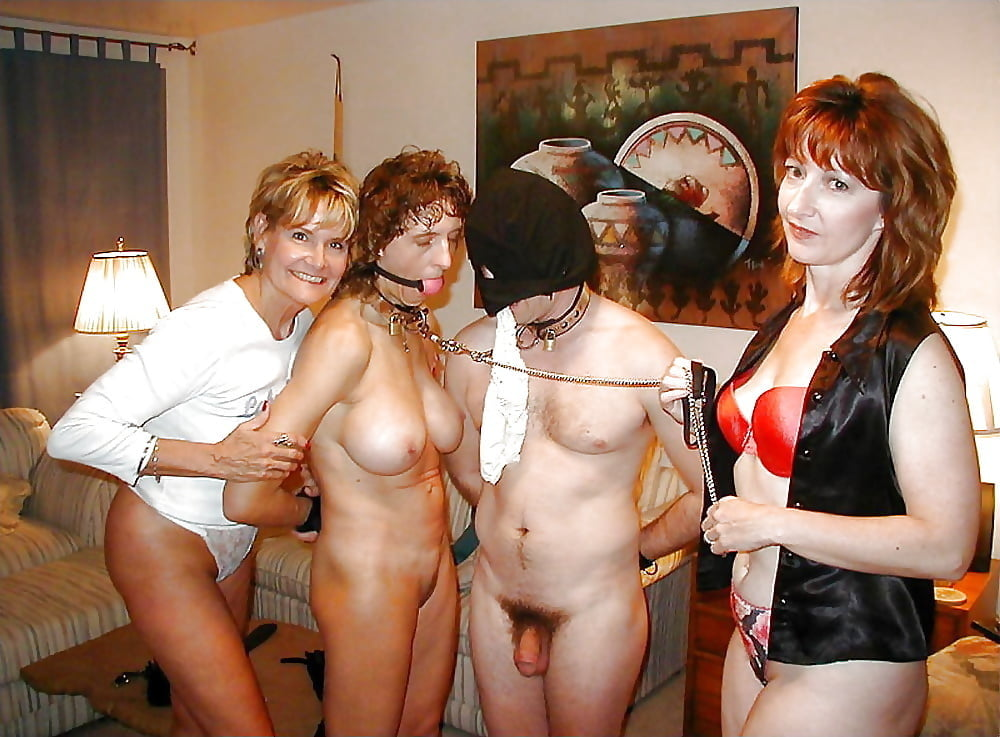Bdsm couple with young slave