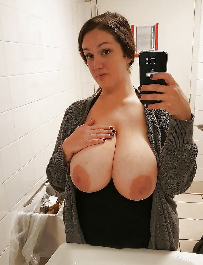 Woman holding big tits, makeing asshole wide with food