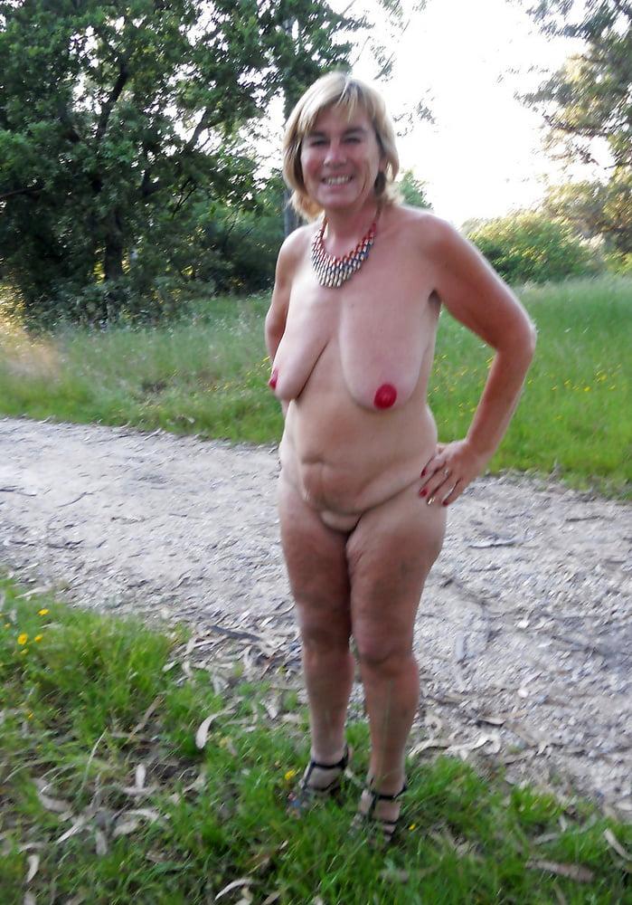Nude granny on beach