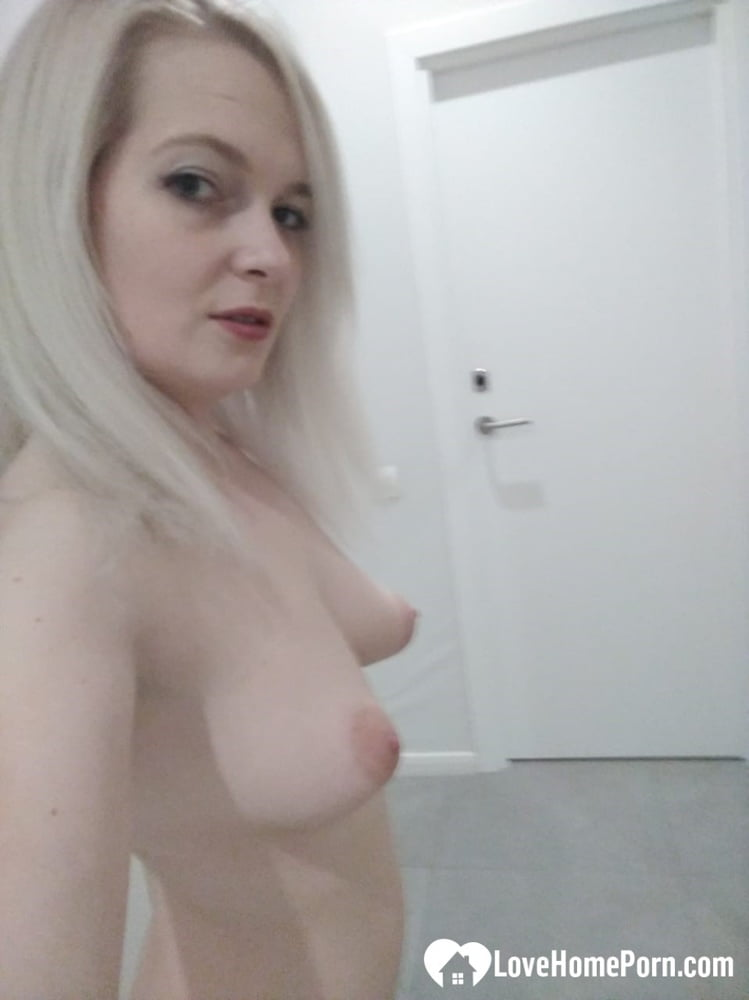 Platinum blonde loves to show off her tits - 25 Pics