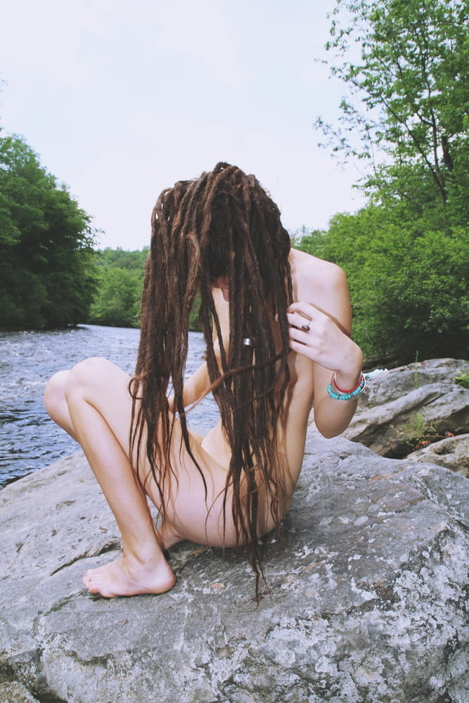 Two Naked Girl With Dreadlocks Show Their Shaved Pussies