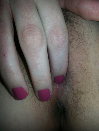 rubbing her pussy