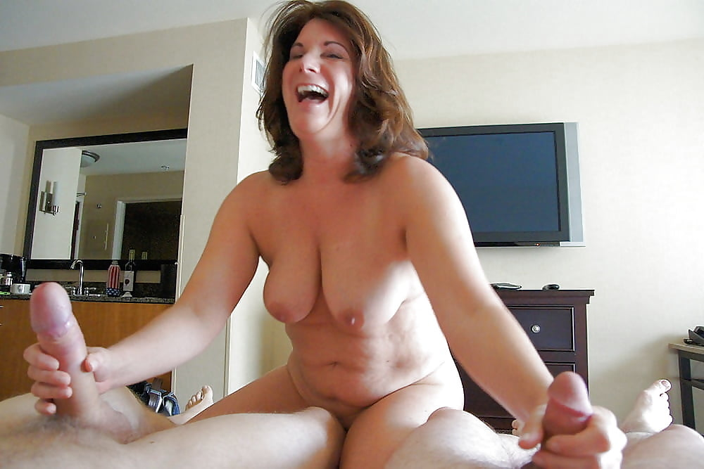 and-busty-giving-a-hand-shaved-bare-pussy