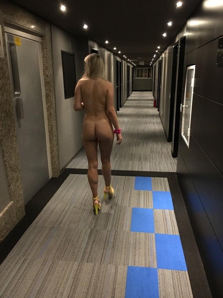 Naked hotel hallway exhibitionism