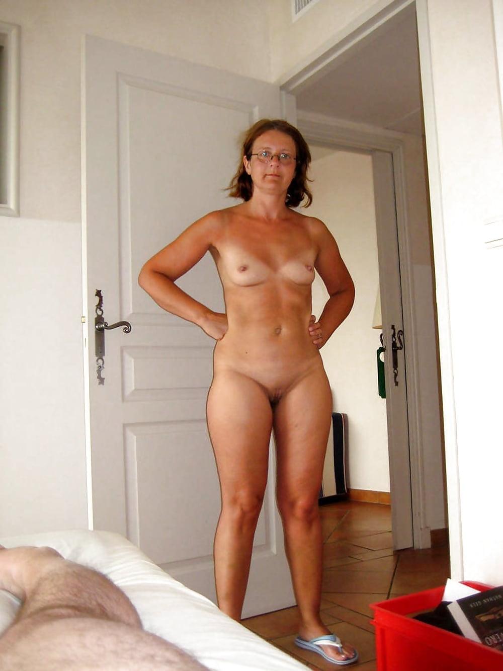 Mature caught nude