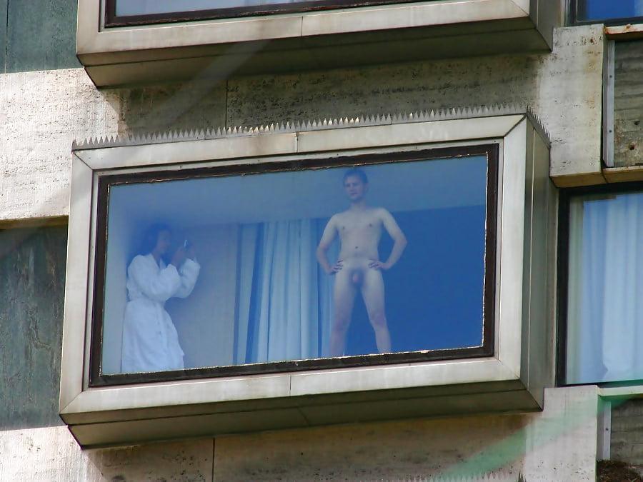 Naked man hotel window — photo 8