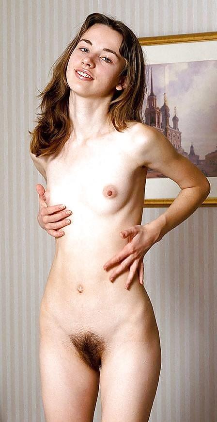 Slim redhead julia yaroshenko shows tiny tits and nice hairy pussy