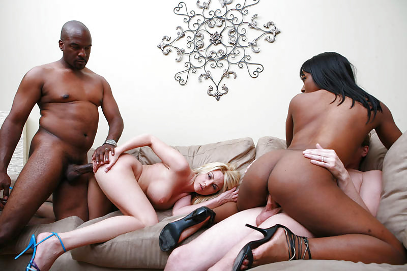 Sexy swinger participating in an interracial orgy