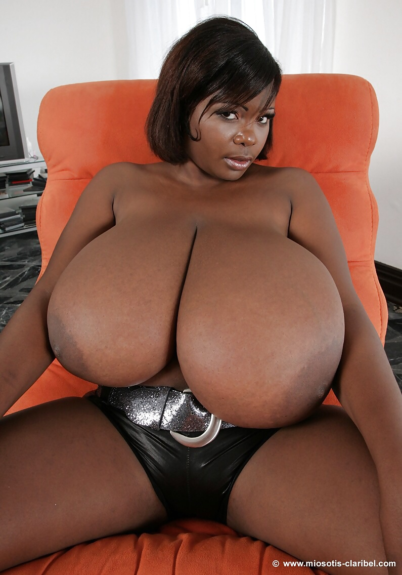 Super busty black young lady displays her massive saggy breasts such huge natural boobs