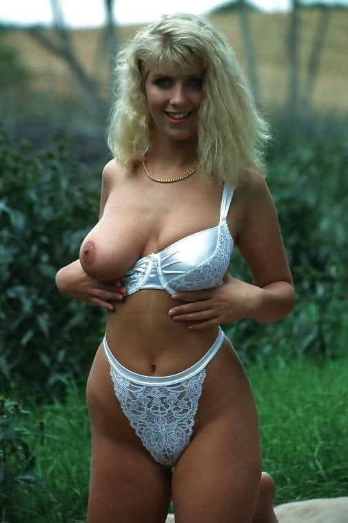 Beautiful blonde woman showing off outdoors - 15 Pics