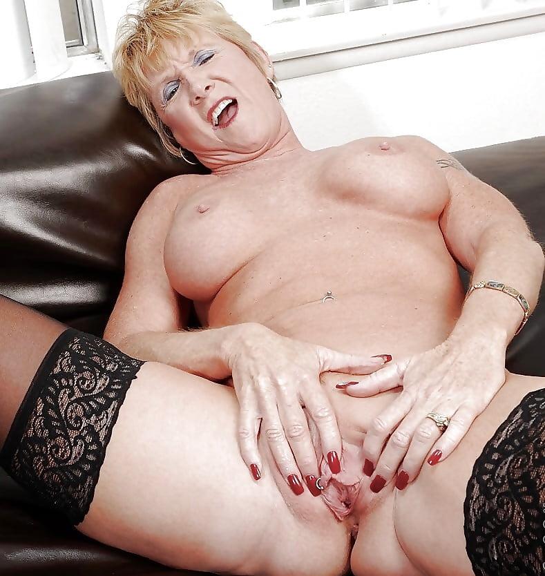 Blowjob porn photo of hot blonde mature