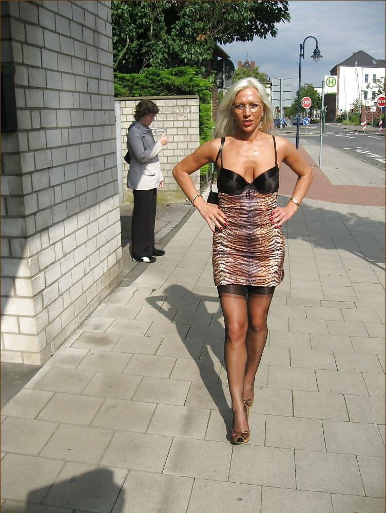 Sexy milf outdoors in black seamed stockings - 15 Pics