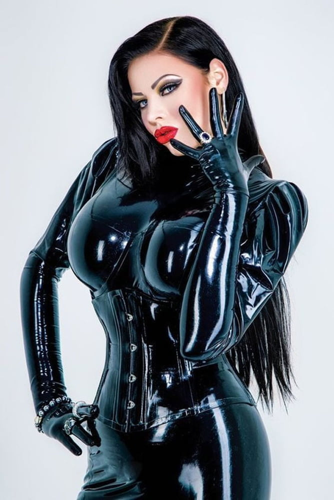 Kinky Latex European Brunette Has Sex With A Rubber Doll