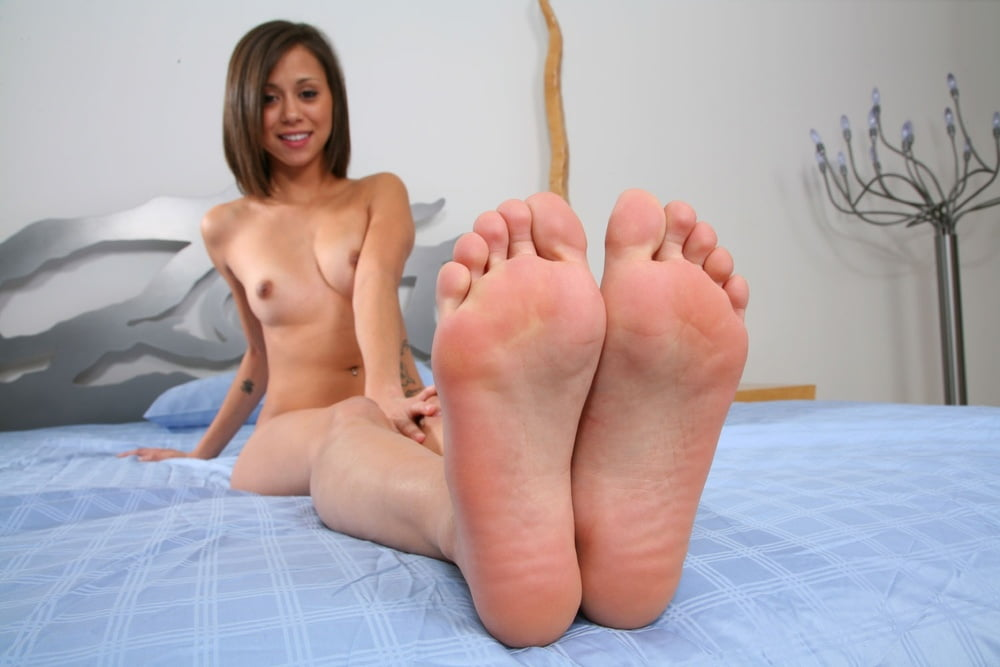 Cute Japanese Girl Shows Naked Twat While Giving Footjob In Bare Feet