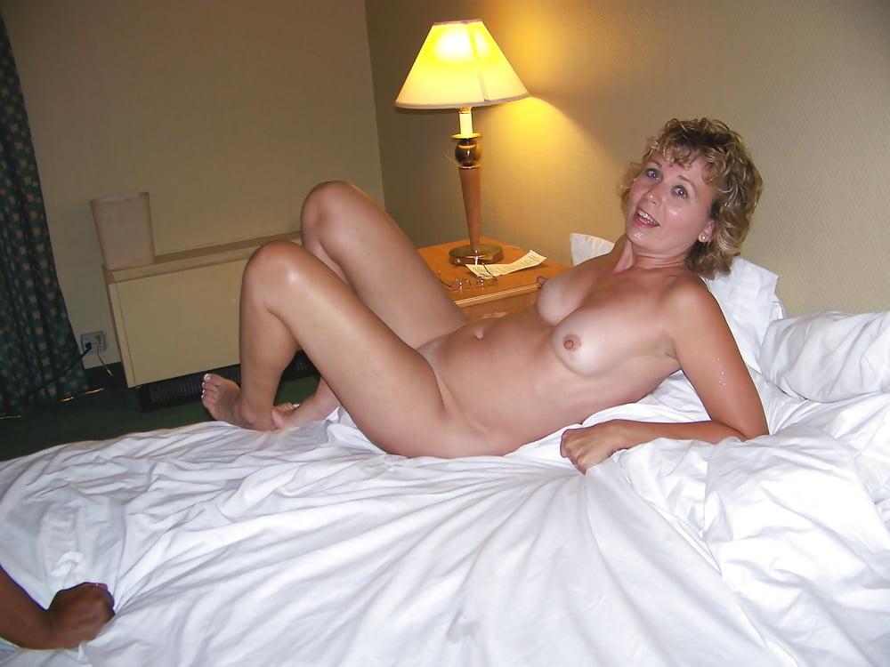 Cheerful Mature Woman Imitating Model Pose Stock Photo