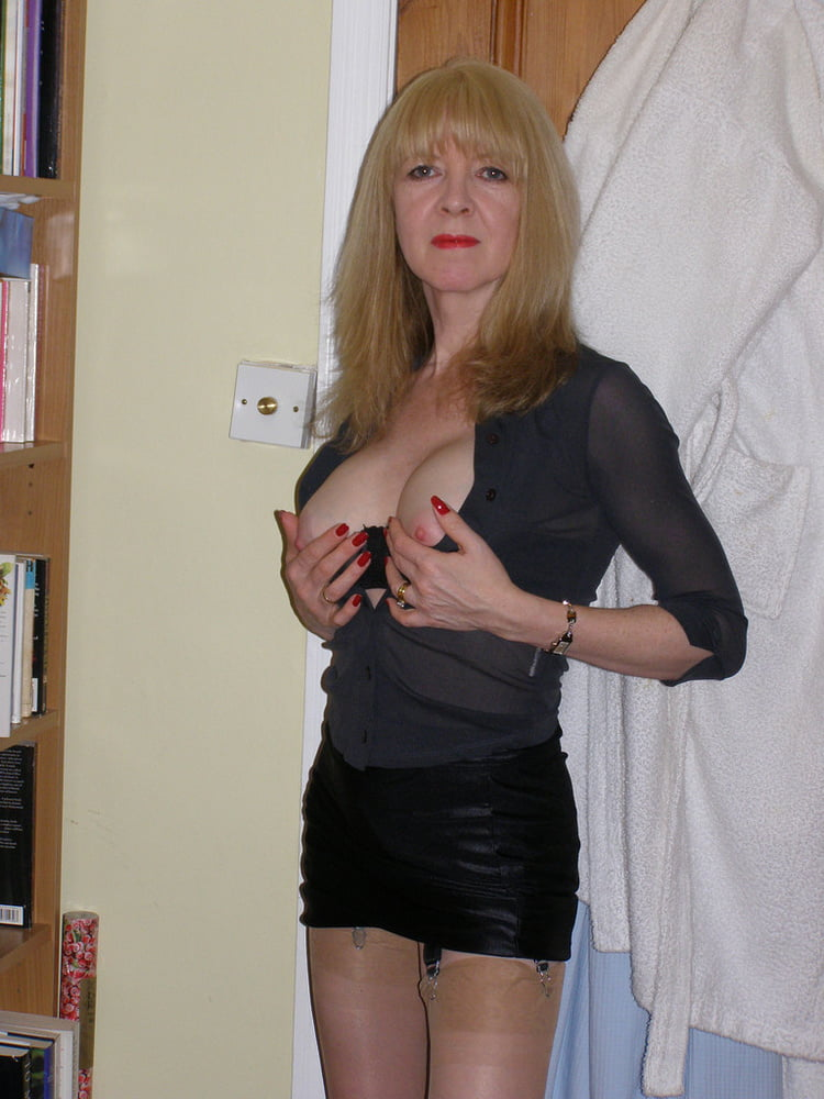 Posing in Miniskirt - 38 Pics