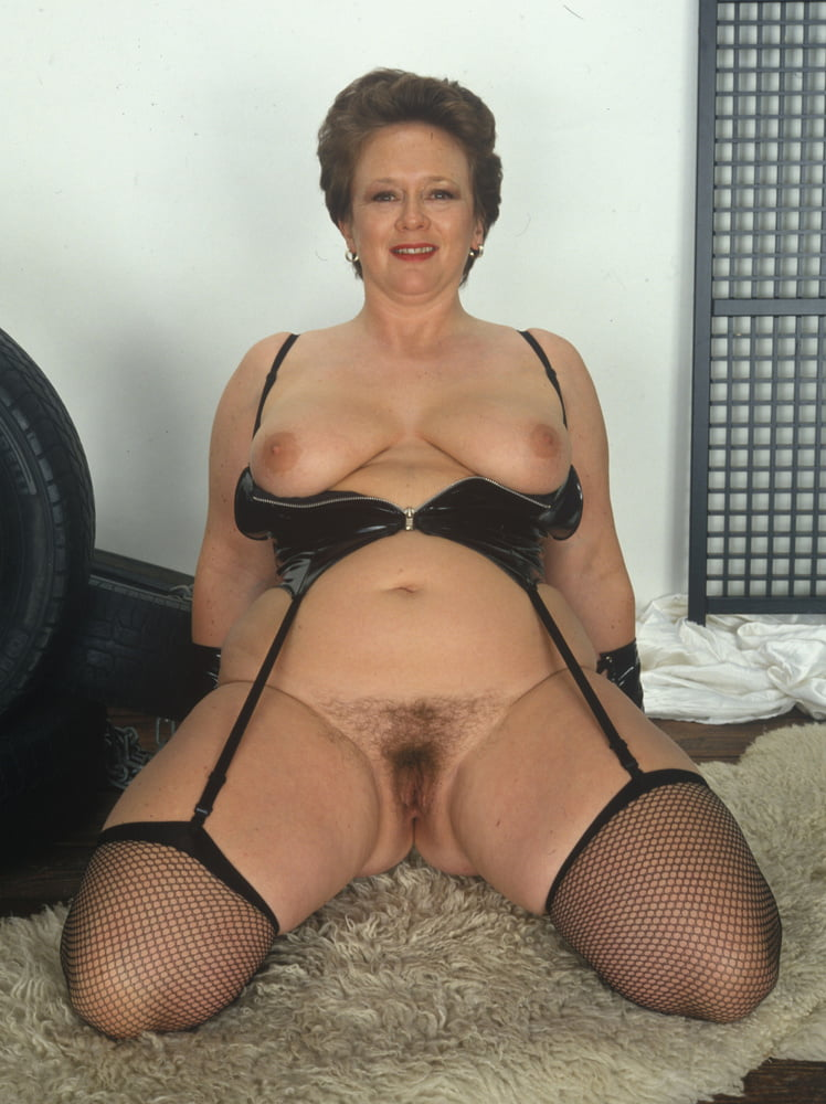 Redhead Mature Lady Hotly Poses In Sexy Lingerie