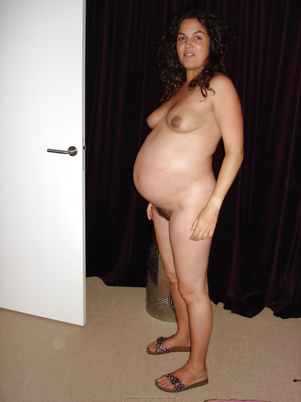 Naked Pregnant Woman With Her Husband Stock Image