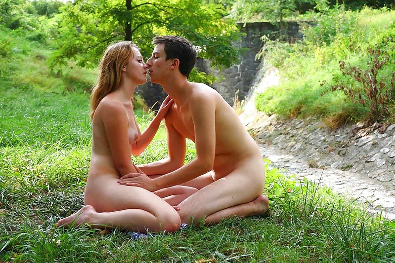 Erotic nude outdoors with her legs open