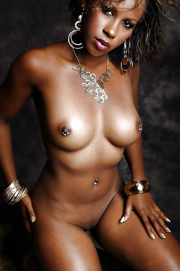 Skinny ebony babe with a pierced clit nude in high heels