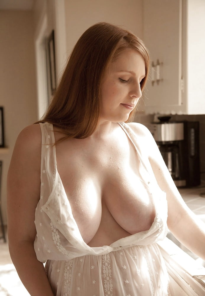 Hot milf with big boobs takes nightie off on bed in hot pics