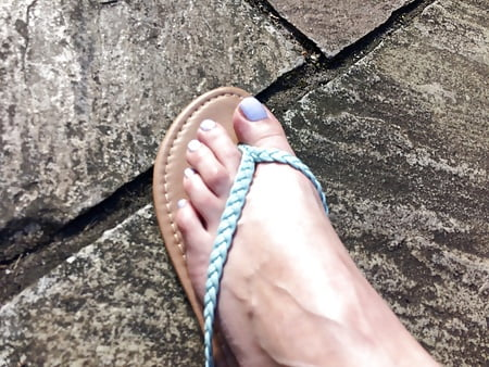 painted toe nails in sandals