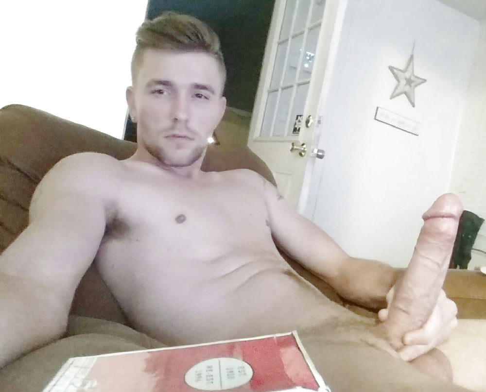 Naked guys with impressive boners are relaxing on sofa