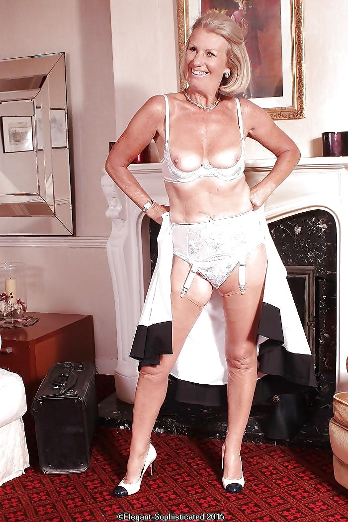 Beautiful mature woman in lingerie stock image