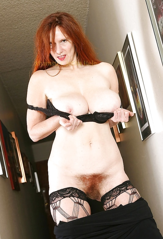 nude-mature-redhead-naked-innie-outie-pussy