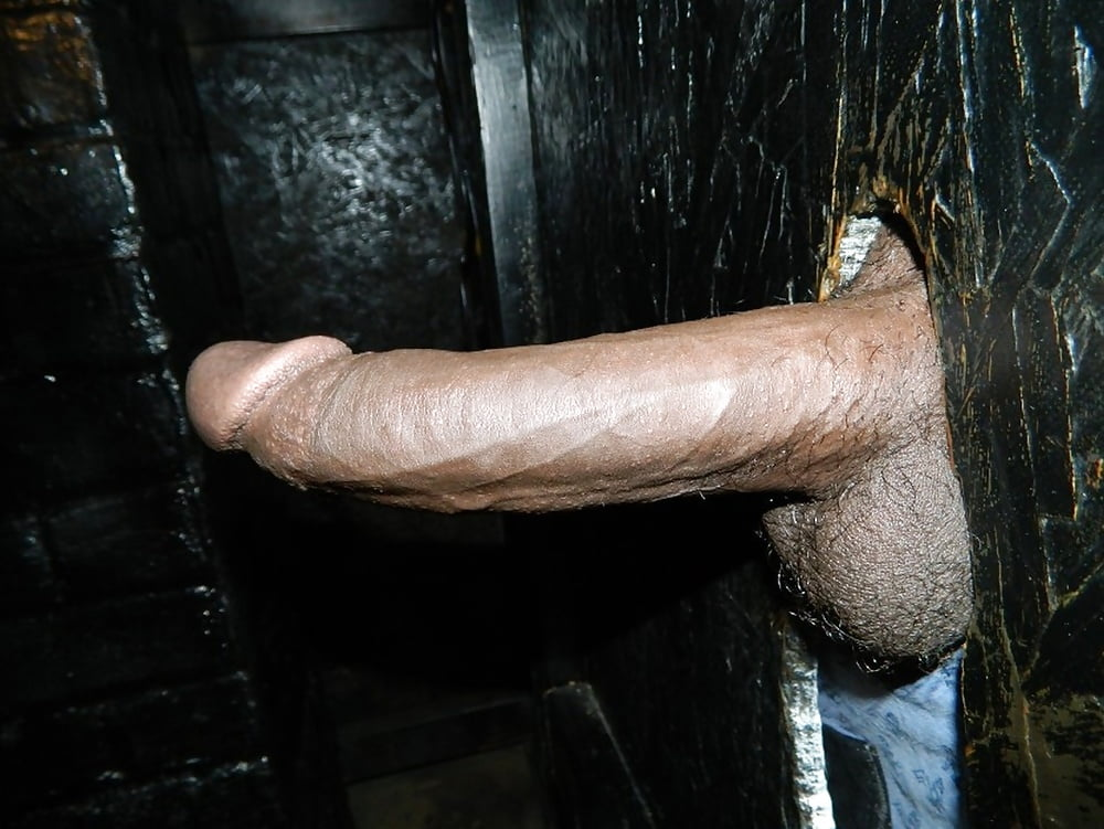 Jerking dicks in a gloryhole