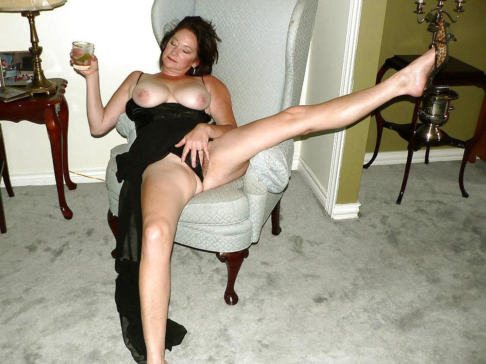 Waist up portrait of elegant mature woman looking