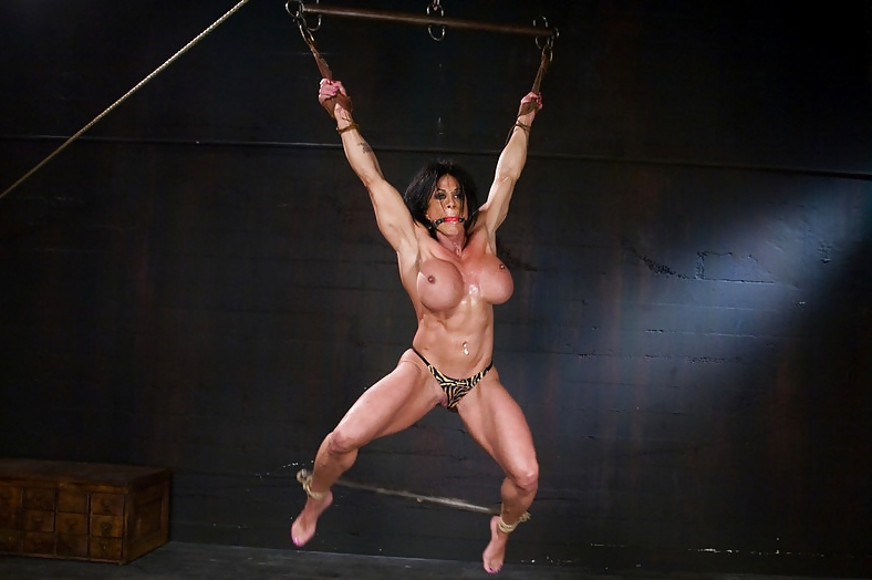 Naked female bodybuilder bondage