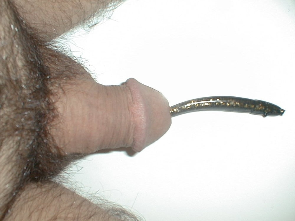 Man pushing worms out of his ass hole