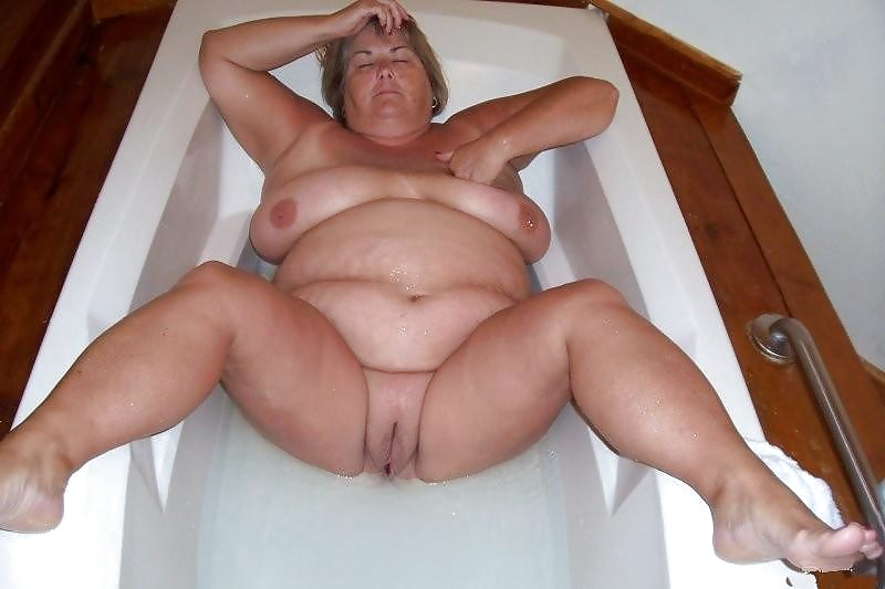 Mature woman relaxing in hot tub