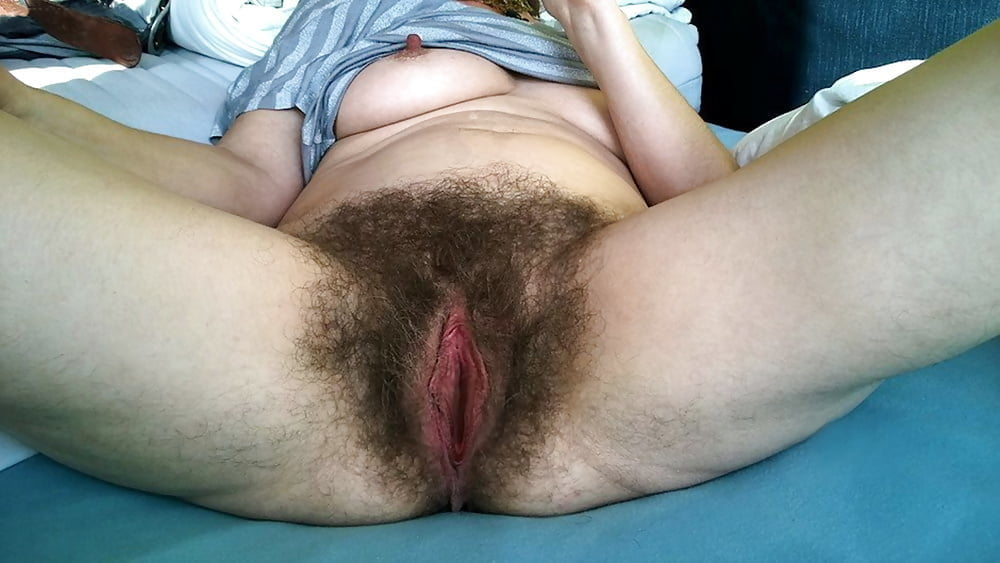 Hairy black babe takes cock deep in her cunt jungle