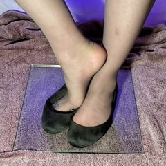 Feet In Pantyhose And Flats