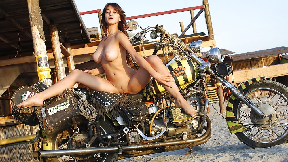 Shaved Girlfriend Posing Naked With Her Dirt Bike