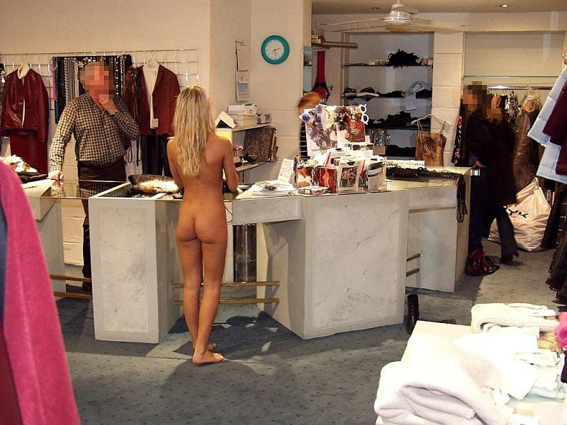 Naked Girl In The Store Shows Her Legs And Other Parts Of Her Body