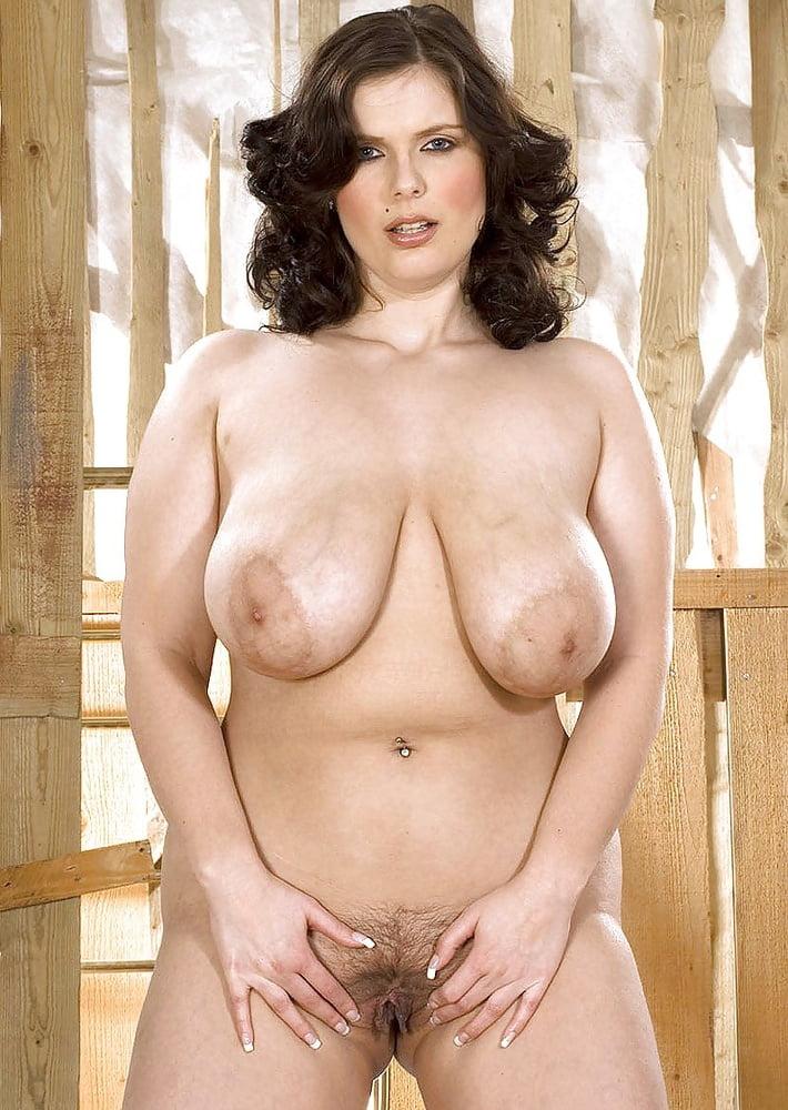 Busty Brunette Plumper Deborah Blue Poses In Kinky Fetish Gear