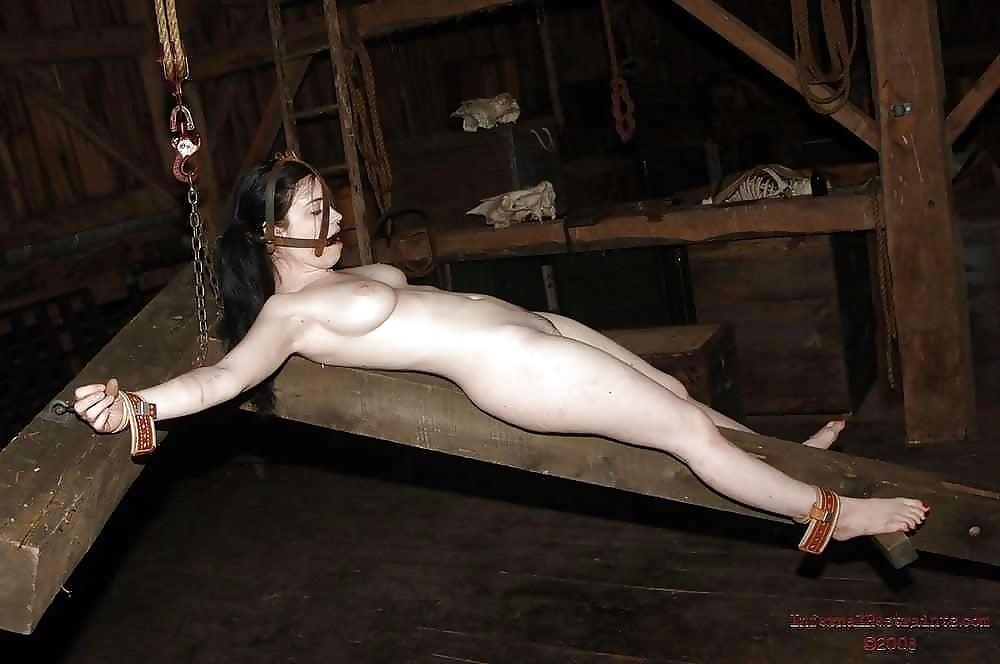 Naked female bodybuilder bondage