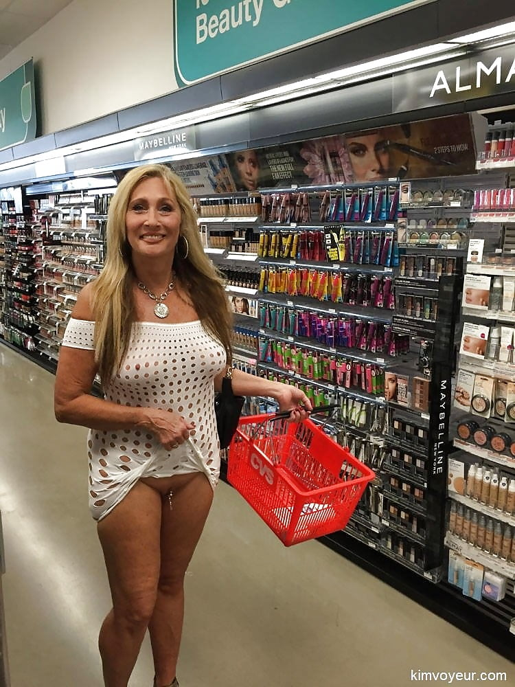 Another brave amateur chick flashing her pussy in a store
