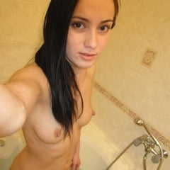 Hot Babe Posing Naked In The Bathtub
