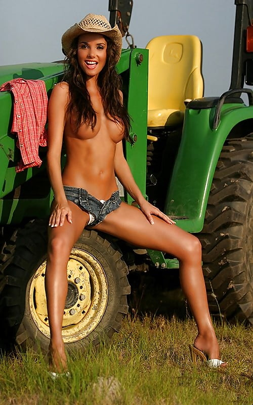Girls naked on a tractor