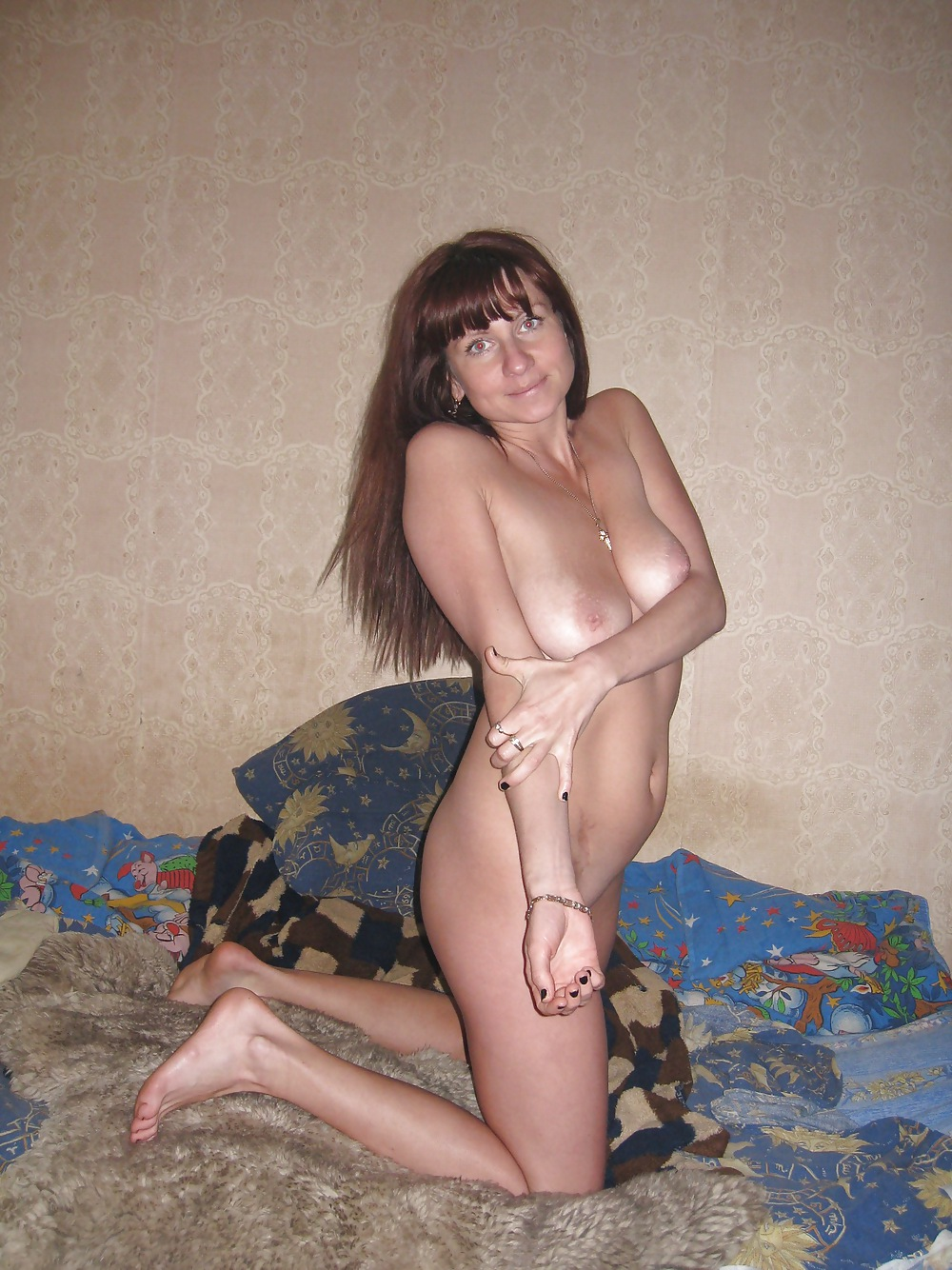 Wife posing naked after getting fucked